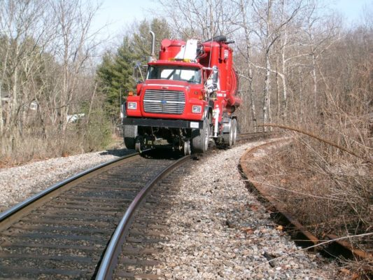 wet vacuum truck on railroad
